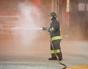 fireman extinguishes the great fire with the hydrant