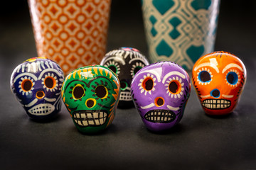 Small mexican skulls on table