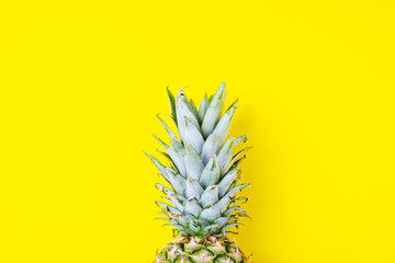 copy space pineapple over yellow background, minimalist concept, summer, holiday, nutrition