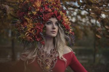 Beautiful blond nymph wearing impressive, colorful coronet
