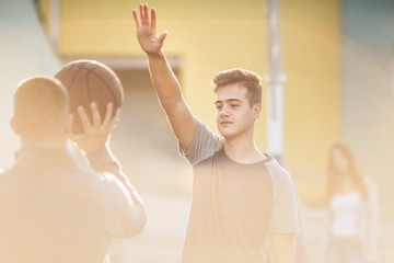 Teenagers playing basketball