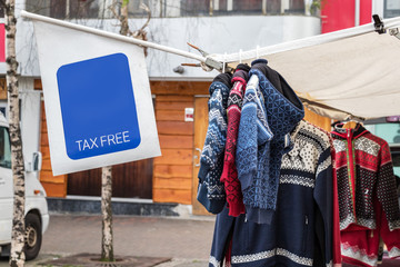 A tax free sign hanging on a street clothes shop in Tromso, Norway.