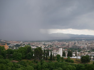 Wall of dark clouds rolling over the city of Granada, Spain