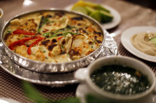 Tajien Habbar Abyed, a casserole consisting of squid, octopus and white sauce, is pictured at Ibn Hamido seafood restaurant in Port Said city
