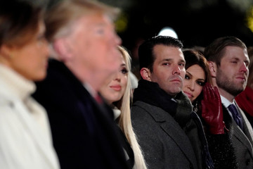 U.S. President Trump's children watch their father participate in the 96th annual National Christmas Tree Lighting ceremony near the White House in Washington