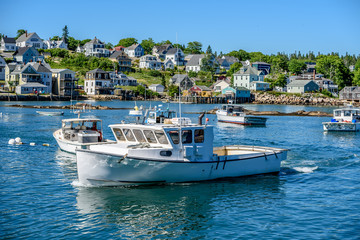 Maine Lobster Boats Anchored in the Bay in Front of a Quaint New England Village