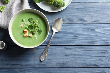 Fresh vegetable detox soup made of broccoli and green peas served on table, top view. Space for text
