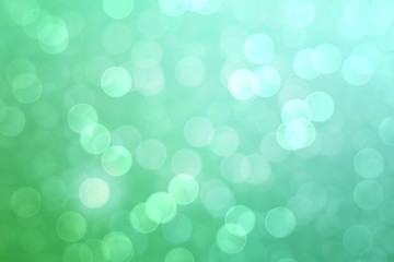 Abstract green bokeh lights effect, soft blurred background