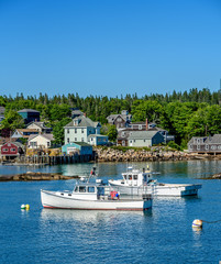 Maine Lobster Boats Anchored in a Bay in Front of a Quaint New England Village