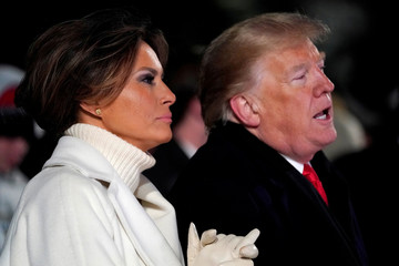 Tears form on U.S. first lady Trump's cheeks in the cold weather as she and President Trump participate in the National Christmas Tree Lighting ceremony in Washington