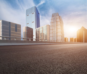 Overpass, asphalt pavement and modern architecture    Urban road surface background