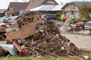 Debris Piled Up During Tornado Destruction Cleanup
