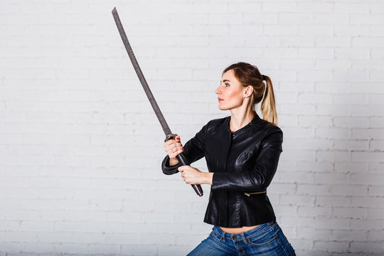 a young woman with a large sword