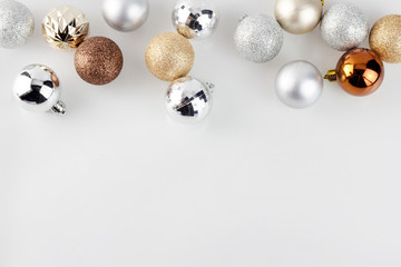 Gold and Silver Christmas ornament balls on clear white background