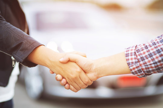 Closeup of a business man hand shake between two colleagues greet , Represents Friendship is good,success, congratulations. Good deal. Close-up of handshaking. Smooth business. purchase buy car new.