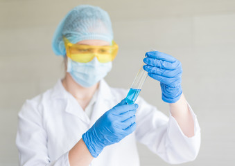 Scientist with a test tube working at the laboratory