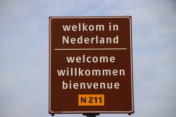 sign on the border in 4 languages to welcome travelers in the Netherlands at the ferry of Hoek van Holland