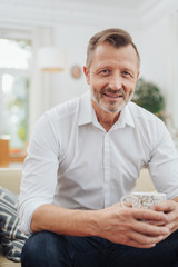 Middle-aged man relaxing with a mug of coffee