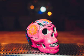 Mexican Culture Celebration: Colorful colourful hispanic Mexican ceramic pottery Day of the Dead Dia de los Muertos skulls on display at a market in Mexico.
