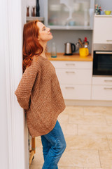 Young redhead woman standing relaxing indoors