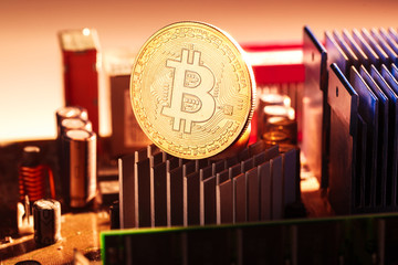 Image of bitcoin and processor on red background