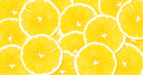 Background of yellow, large lemons filling tightly the entire surface