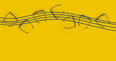Background of sunglasses hanging on a music staff on a yellow background