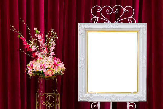 Luxurious white picture frame and red velvet curtains flower decoration with white blank space for advertising wedding concept