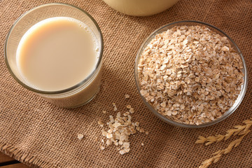 Oat drink and cereal flakes top view