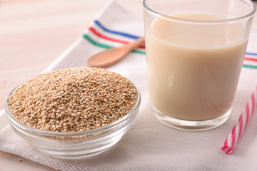 Quinoa drink and cereal grains in bowl in kitchen elevated