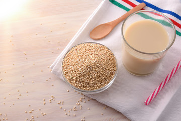 Quinoa drink and cereal grains in bowl in kitchen top