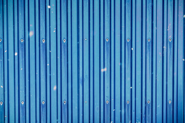 Blue surface container warehouse lined with snowing