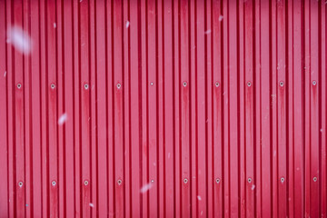 Red surface container warehouse lined with snowing