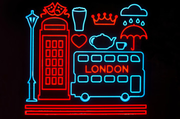 Graphic neon lights depicting iconic symbols of the city of London, England, including a double decker bus and telephone box