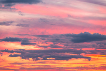 Beautiful soft dramatic sunrise orange pink sky with clouds