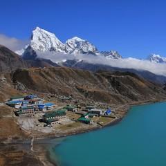 ..Turquoise Gokyo lake, village and mount Cholatse