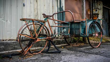 Old rusty abandoned riksha