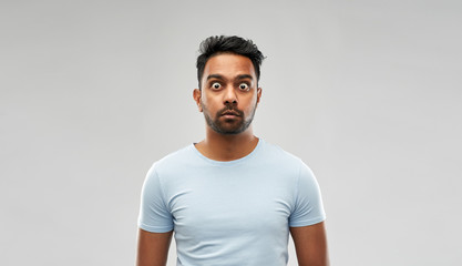 emotion, expression and people concept - shocked or scared man in t-shirt over grey background Wall mural