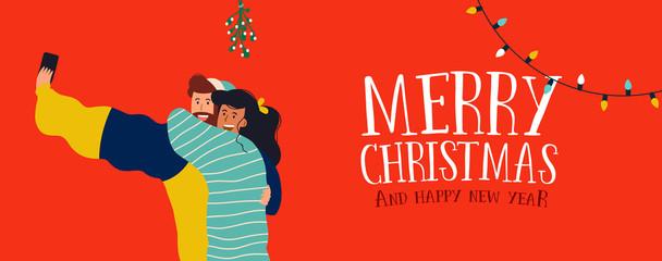 Christmas banner of couple selfie under mistletoe