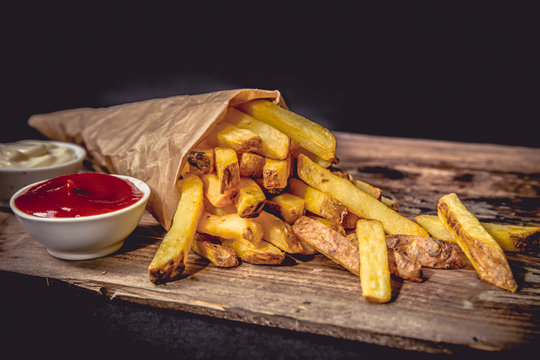 French fries Pommes Frites on Wood Dark