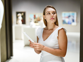 Woman observing museum exposition