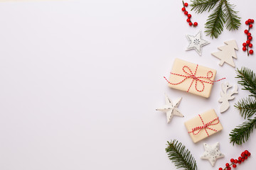 Christmas composition. Wooden decorations, stars on white background. Christmas, winter, new year concept. Flat lay, top view, copy space.