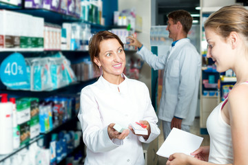 Female pharmacist in a white coat