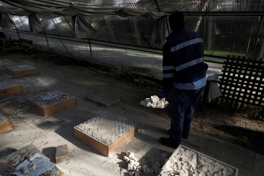 Paver Jorge Duarte works at his empty classroom of the pavers school in Lisbon