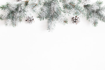 Christmas composition. Border made of fir tree branches, pine cones on white background. Christmas, winter, new year concept. Flat lay, top view, copy space