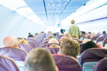 Passengers sit inside airplane - people traveling