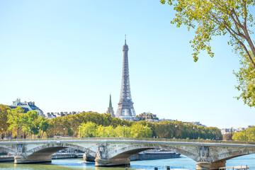 Eiffel tower and bridge on Seine in Paris, France