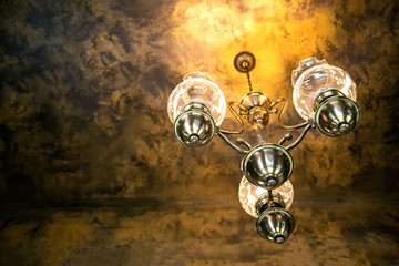 antique chandelier on a dark vintage background - selective focus, space for text