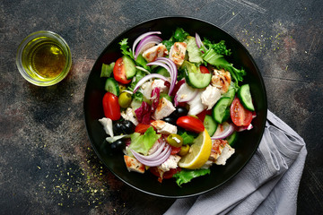 Vegetable salad with grilled chicken fillet.Top view with copy space.