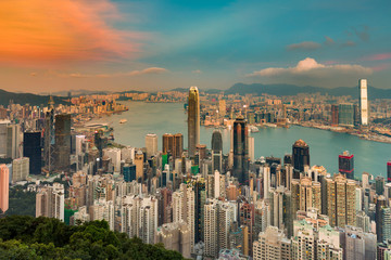 Hong Kong crowded city aerial view over Victoria bay, cityscape background
